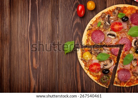 Italian pizza with pepperoni on wooden table. Top view with copy space - stock photo