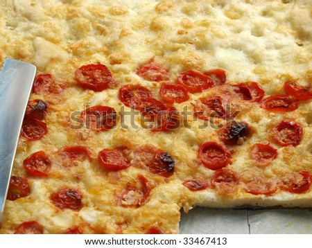 Italian Pizza with tomato topping useful as a background