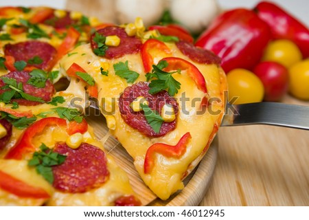 Italian pizza with vegetables and salami - stock photo