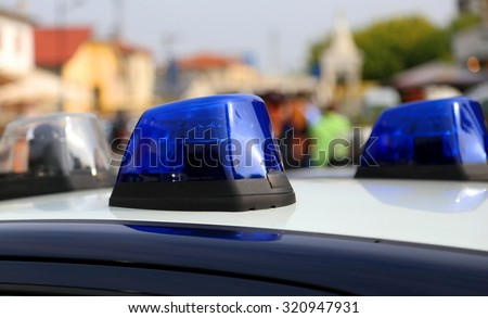 italian police car siren while patrolling in the city - stock photo
