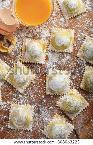 Italian ravioli with courgette and ricotta filling. - stock photo
