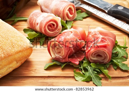 italian raw ham rolled with cheese and mozzarella. - stock photo