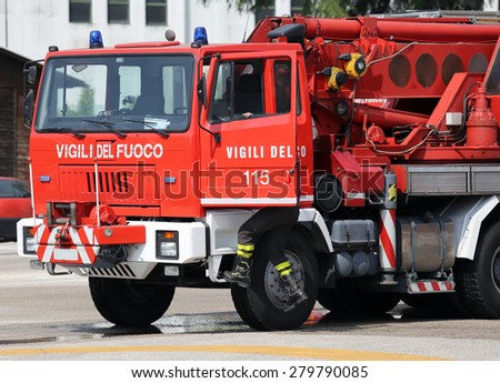 italian Red fire trucks with huge crane - stock photo