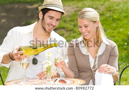 Italian restaurant terrace elegant couple celebrate drink wine summer day - stock photo