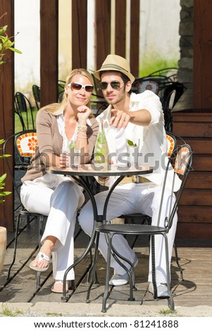 Italian restaurant terrace elegant couple sitting drink water summer day