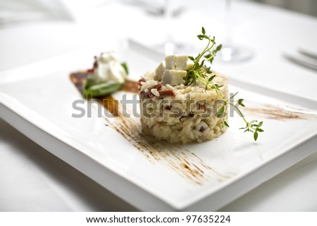 Italian risotto serving on restaurant table, risotto - stock photo