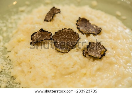 Italian risotto with black truffle. Shallow dof. - stock photo