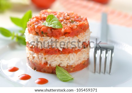 Italian risotto with tomatoes in layers - stock photo