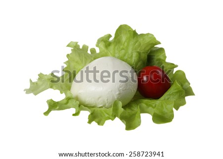 Italian salad - Mozzarella cheese with dark red tomato on green lettuce leaf isolated on white background - stock photo