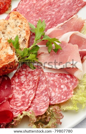 Italian sausage assorted with roasted bread and lettuce - stock photo