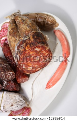 italian sausages on beautiful deco plate - stock photo