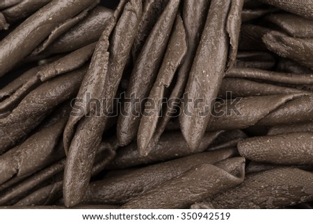 italian seppia pasta fusilli macaroni with cuttlefish ink, for background