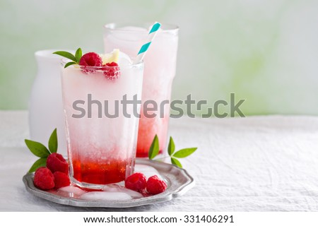 Italian soda drink with berry syrup and coconut milk - stock photo