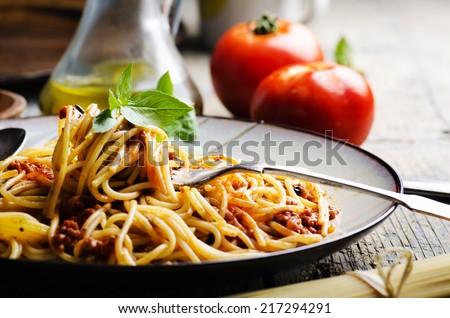 Italian spaghetti on rustic wooden table - stock photo