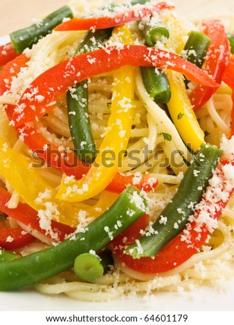 Italian spaghetti with peppers and green beans. Shallow dof. - stock photo