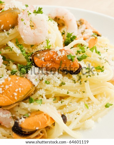 Italian spaghetti with shrimps and mussels. Shallow dof. - stock photo