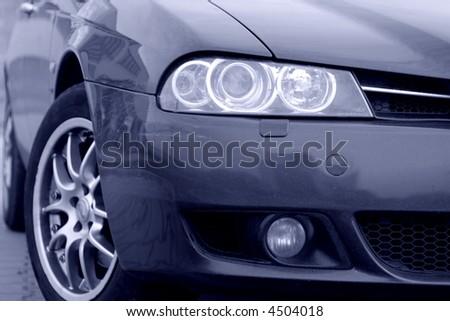 ITALIAN SPORT CAR, FRONT SIDE, HALF - stock photo
