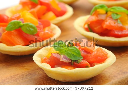 Italian styles appetizer of tomatoes, garlic and basil.