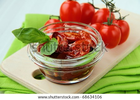 Italian sun dried tomatoes in olive oil, glass jar - stock photo