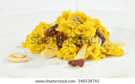 Italian sweet risotto w banana and dates - stock photo