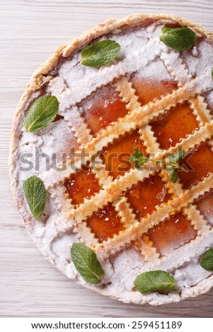 Italian tart with apricot jam close up on the table. vertical top view - stock photo