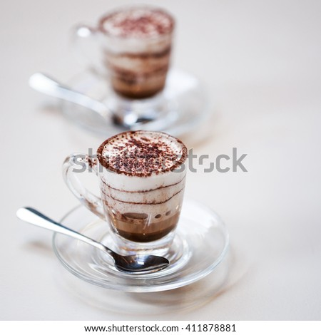 Italian traditional coffee macciato, made in Milan. This beverage contains dark chocolate, hot frothed milk and espresso. - stock photo