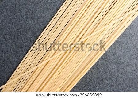 Italian traditional spaghetti on grey background - stock photo