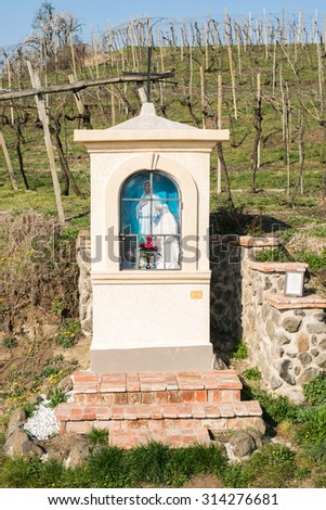 Italian traditional votive temple in the countryside dedicated to the Virgin Mary to propitiate the harvest - stock photo