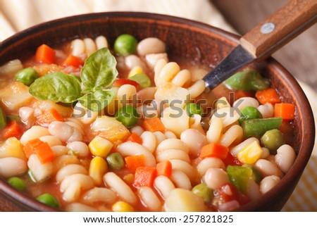 Italian vegetable minestrone soup in a bowl macro. Horizontal  - stock photo