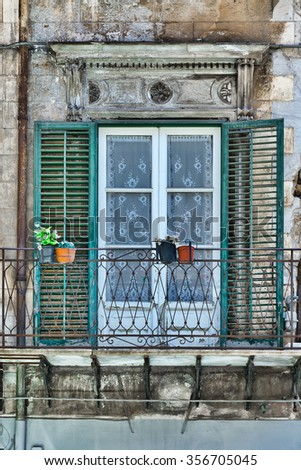 Italian Window in Palermo with Open Wooden Shutters, Decorated with Fresh Flowers