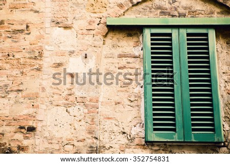 Italian Window with Closed Wooden Shutters - stock photo