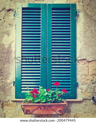 Italian Window with Closed Wooden Shutters, Decorated with Fresh Flowers, Instagram Effect - stock photo