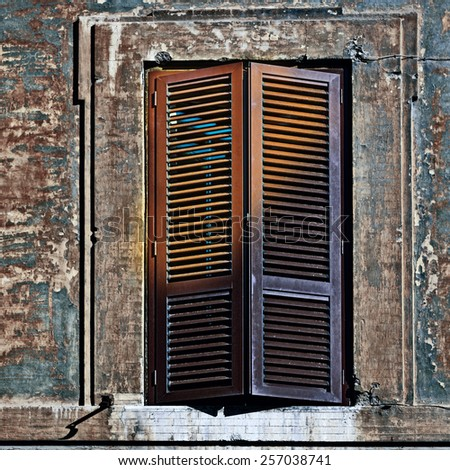 Italian Window with Closed Wooden Shutters in the Rome, Vintage Style Toned Picture - stock photo
