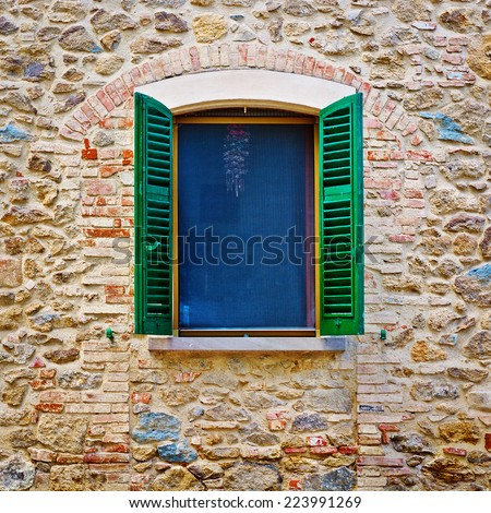 Italian Window with Open Wooden Shutters - stock photo