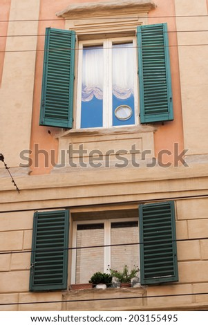 Italian windows with shutters in homes Bologna - stock photo