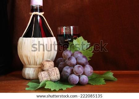 Italian wine Chianti with grape and wine glass - stock photo