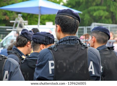 Italians riot policemen during a riot in the city - stock photo