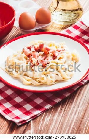 Italiatn traditional cuisine - pasta tagliatelle carbonara on a plate - stock photo