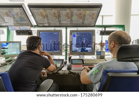 Italy, Bari, International airport, flight control tower, flight controllers working - stock photo