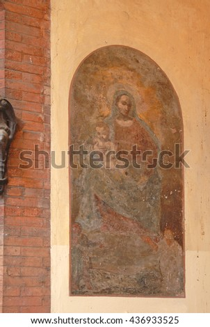 Italy, Bologna Madonna with Child medieval painting in Azeglio street. - stock photo