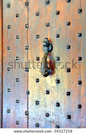 Italy, Bologna old door knocker - stock photo
