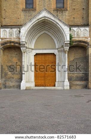 Italy, Bologna Saint Francesco church door. - stock photo