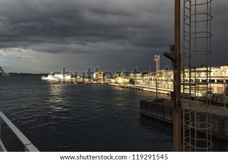 Italy, Calabria, panoramic view of Villa S.Giovanni town from one of the many ferryboats that connect the town with Sicily - stock photo