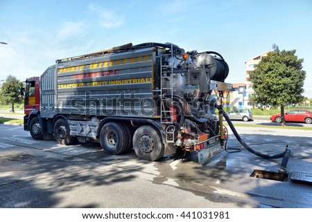 ITALY, CAORLE,15, APRIL, 2016, cleaning truck pumps out the water drain, ITALY, CAORLE,15, APRIL, 2016
