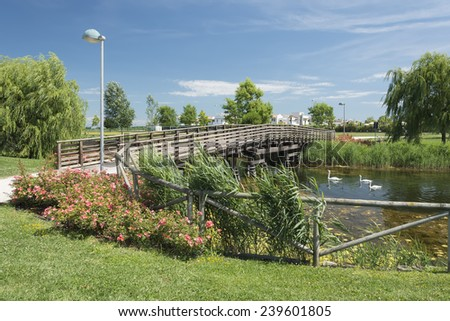Italy, Caorle rest area with a pond and a bridge. Most wanted popoular tourist destination on adriatic coast.