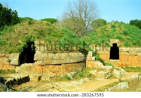 ITALY, CERVETERI - FEBRUARY 22: Etruscan tombs at February 22, 2003 inBracciano,  Italy. Cerveteri is the biggest Etruscan necropilis in Italy. - stock photo