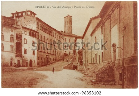 """ITALY - CIRCA 1922: a postcard printed in ITALY shows sepia toned photograph of  Spoleto town. Text in the image means: """"SPOLETO - Arringo Street and Duomo Square"""", circa 1922. - stock photo"""