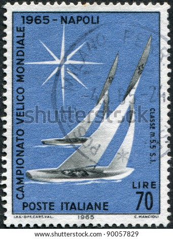 ITALY - CIRCA 1965: A stamp printed in Italy, dedicated to World Yachting Championships, Naples and Alassio, shows Sailboats of 5.5-meter class, circa 1965 - stock photo