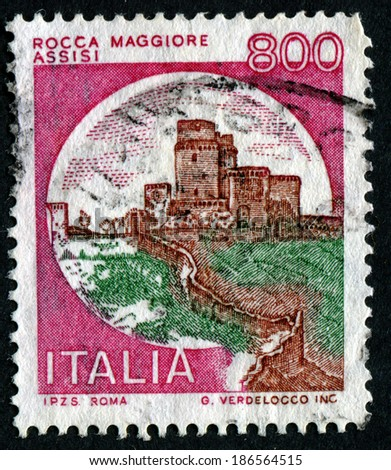 """ITALY - CIRCA 1980: A stamp printed in Italy from the """"Castles"""" issue shows Rocca Maggiore, Assisi, circa 1980. - stock photo"""