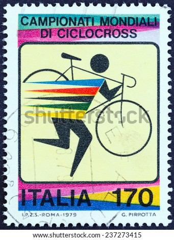 ITALY - CIRCA 1979: A stamp printed in Italy issued for the World Cyclo-cross Championships shows cyclist carrying bicycle , circa 1979.  - stock photo